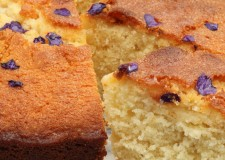 Sweet violet and lemon drizzle cake with slices to show the crumb